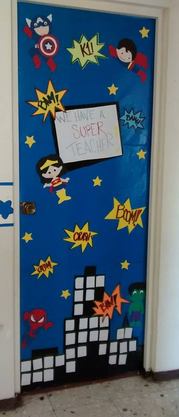 Classroom door decoration super heroes classroom for Puerta wonder woman