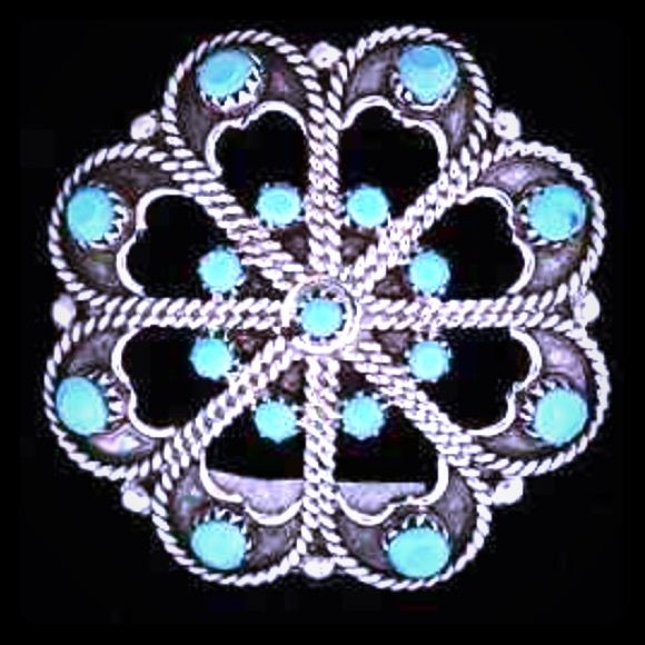 Vintage Zuni Sleeping Beauty Turquoise Pendant Pin Vintage Zuni Native American Turquoise Sterling Silver Hallmarked Petit Point Flower Pendant and Pin. This fabulous piece features intricate petit point stonework. 17 genuine well-matched and perfectly arranged Sleeping Beauty turquoise stones set in the petit-point style, a difficult and labor intensive style of Zuni Pueblo jewelry making. May be worn either as a brooch pin or necklace pendant. Hand-crafted and signed by Zuni artisans, M…