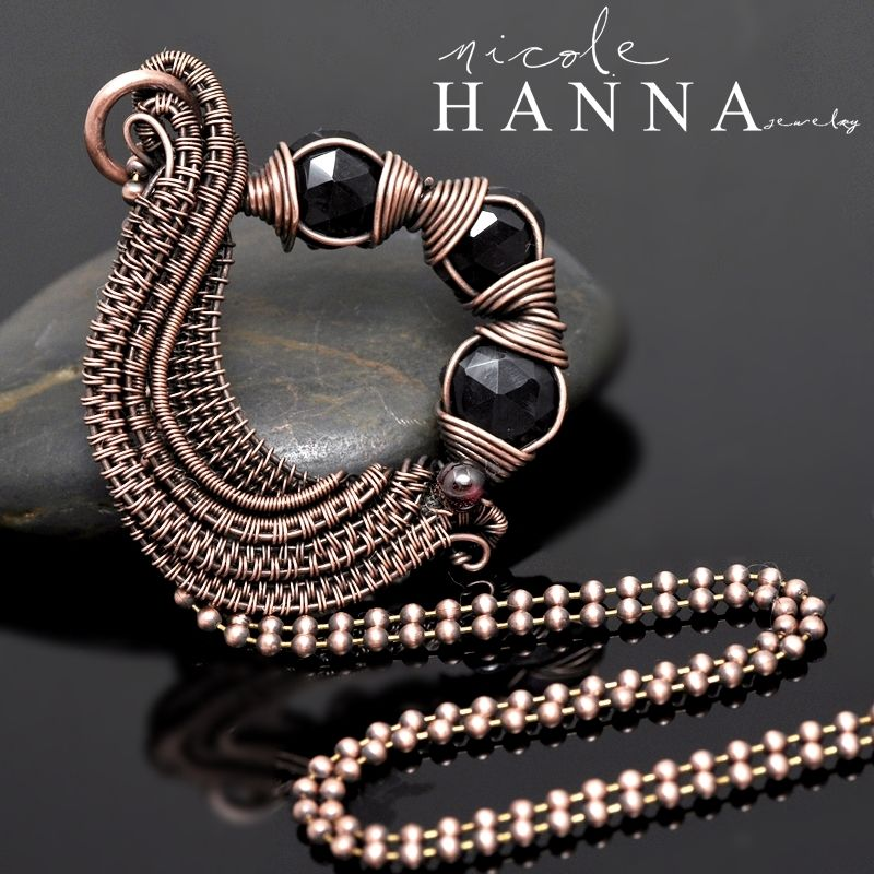This wire wrap pendant features lovely faceted gemstones (black spinel with garnet accent) set in a circular pattern of hand woven, layered copper wire. This wire is coiled in various weaves for depth and texture, and oxidized to emphasize the attention to detail. This pendant measures 5cm in len...