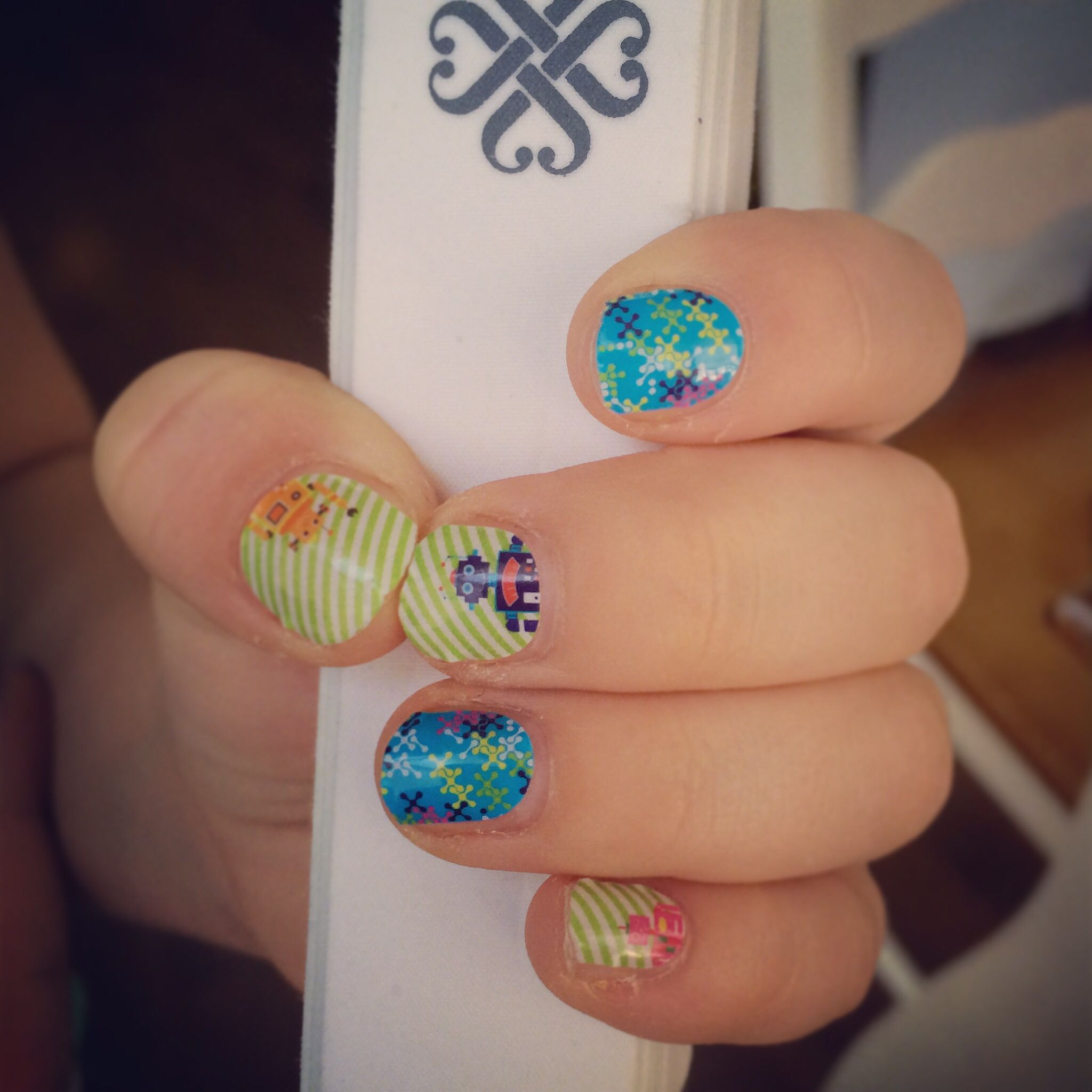 Here are some super cute Jamberry nail wraps, the name is Robots ...