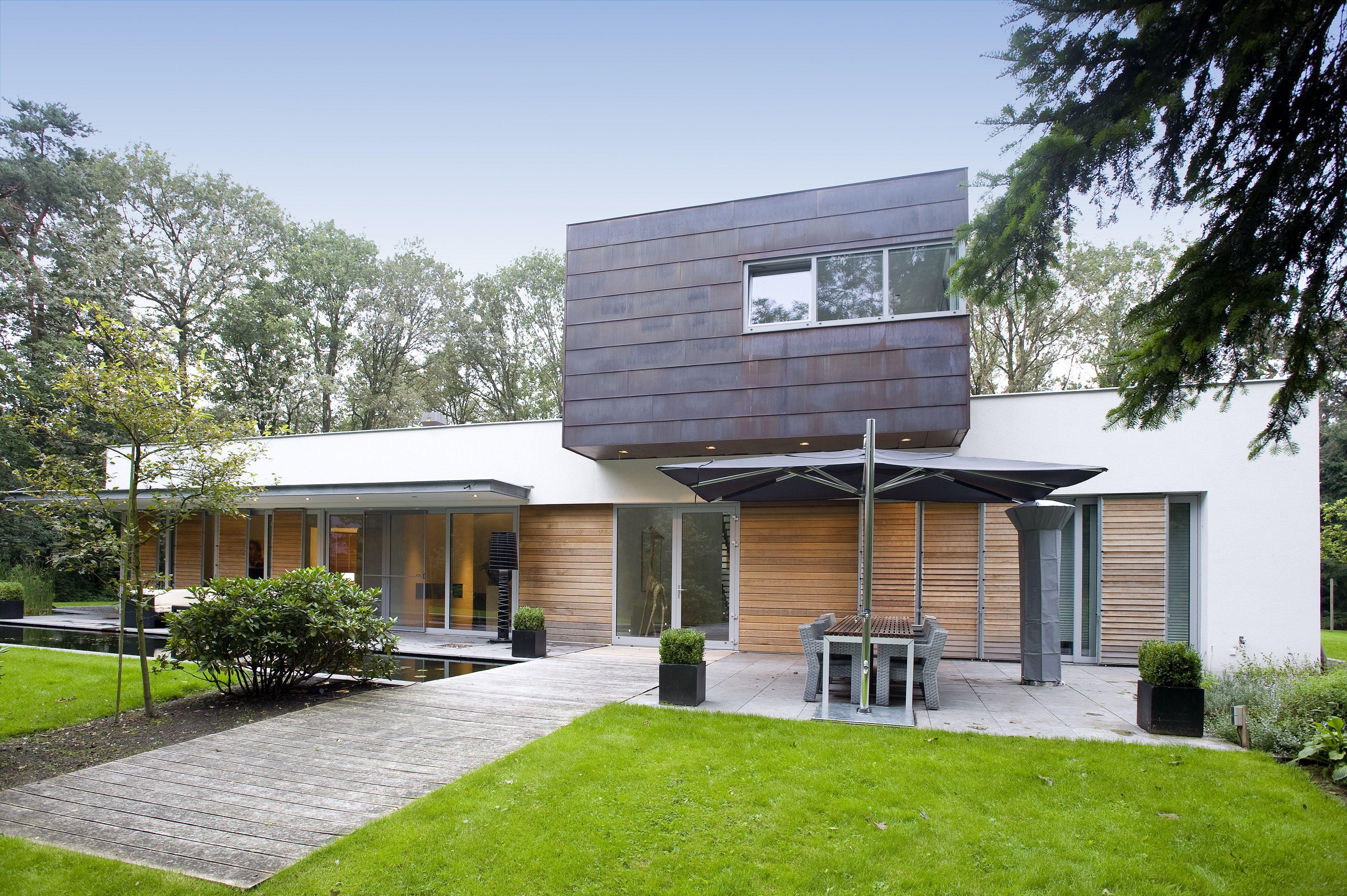 House white stucco, aluminum frames, tinted zinc coated