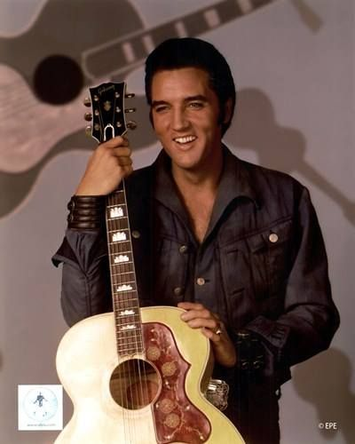 Elvis holding his Gibson guitar, pic from a promo shoot for the Special Comeback '68