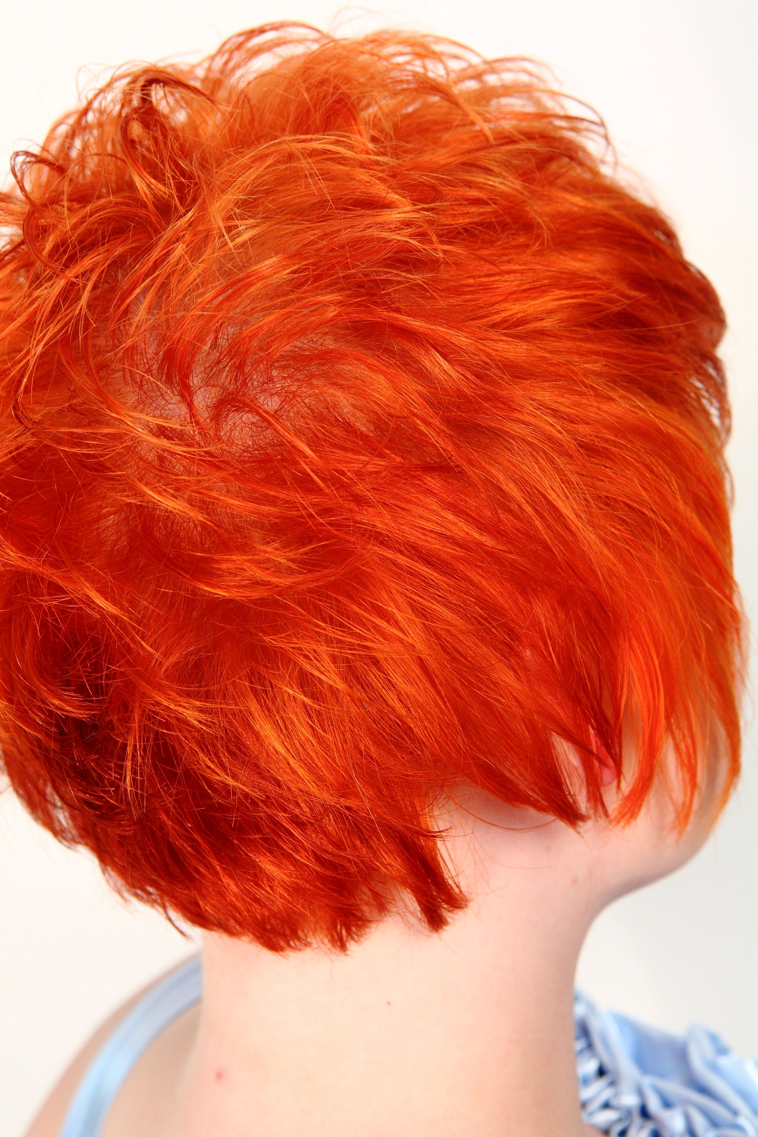 Womans short hair color bright red orange hair created by amanda