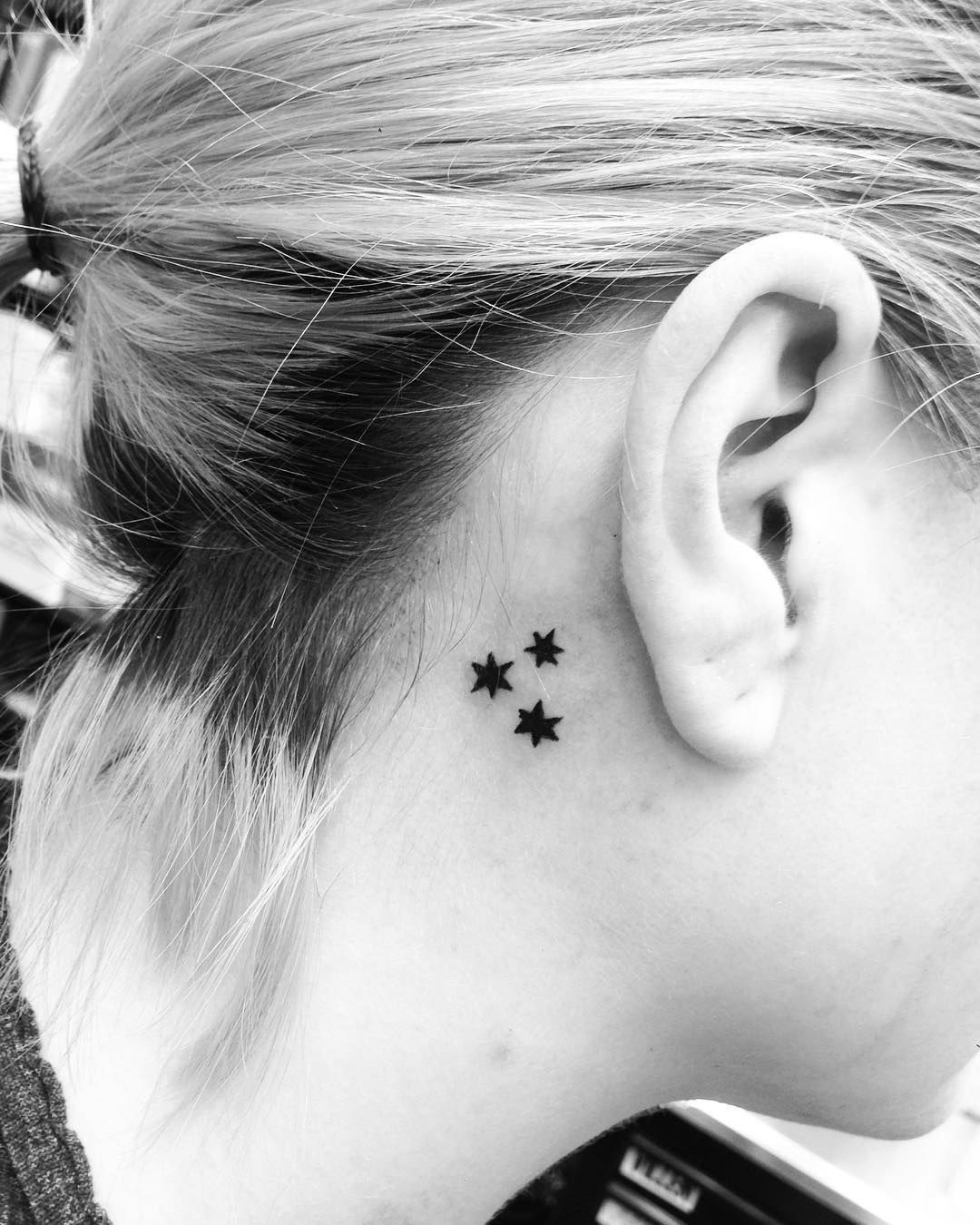 Red bump under nose piercing  These little stars serve up major galaxy vibes  Tattoos