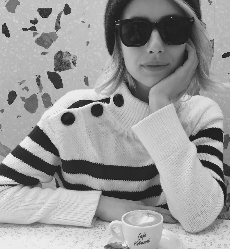 Who made  Emma Roberts' black hat and white stripe sweater?