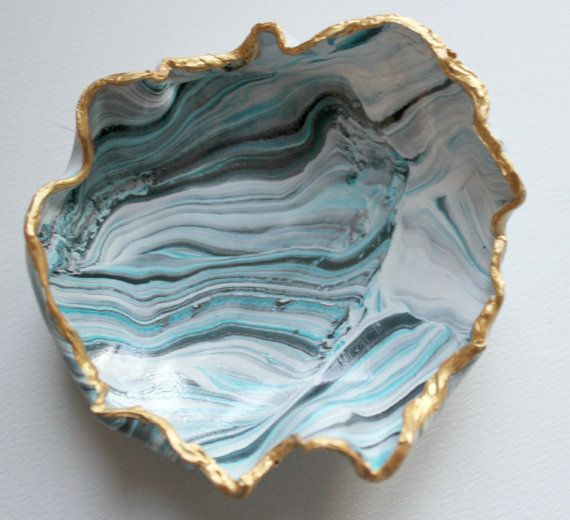 Marbled clay ring dish in blue, white, black and grey with a gold edge    This darling clay ring dish is perfect to hold all of your trinkets in.