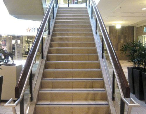 Example Of ADA Compliant Indoor Stair Handrail That Extends Beyond Edge Of  Last Tread AND Raised Slip Resistant Strips On Each Stair Tread Nosing, ...