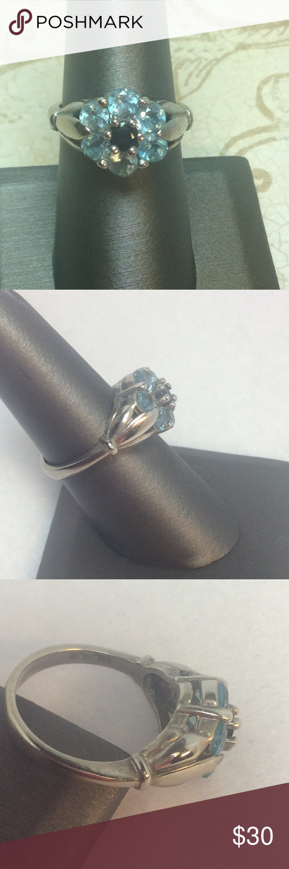 Sterling Genuine Blue Topaz & Sapphire Flower Ring This beautiful blue flower bursts into bloom before your very eyes!  Sterling ring mounting has sculpted opening pod on each side of the flower which reveals this lovely bloom.  Bright blue topaz stones with exceptional clarity form the petals of the flower which surrounds the dark blue sapphire center.  So pretty!  Gently loved.  Excellent used condition. Unlisted Jewelry Rings