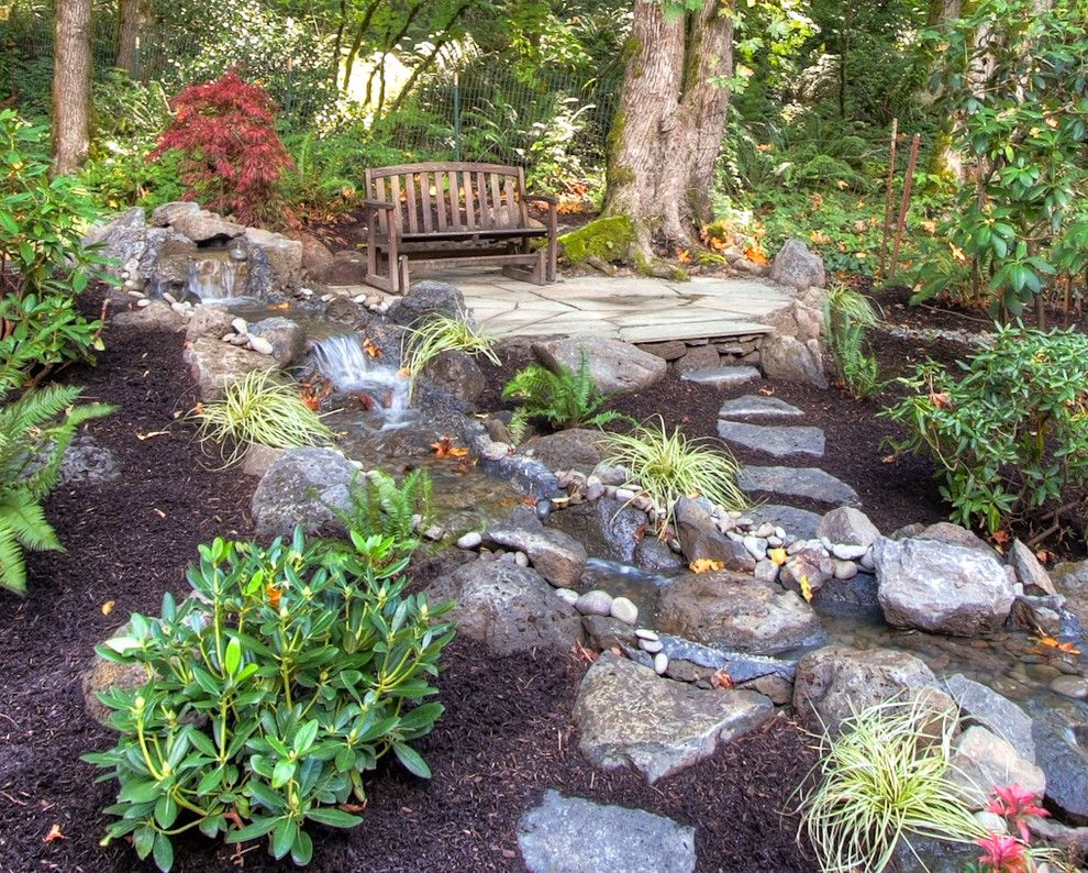 Traditional landscape by paradise restored landscaping exterior design