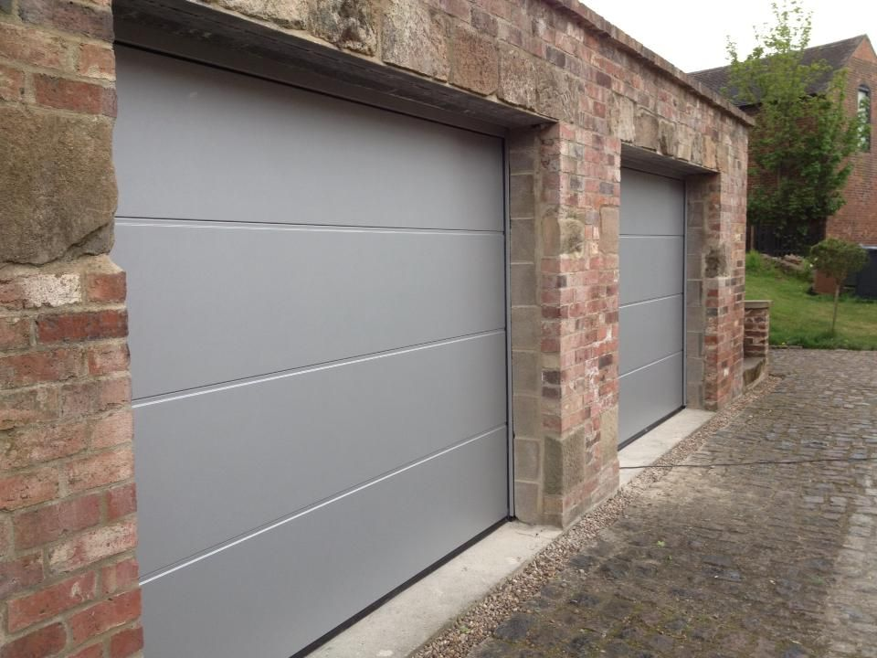 X 2 Hormann Sectional Garage Doors L Ribbed In White Aluminium Remote And Insulated Fitted To Old Brick Garage Doors Garage Doors Sectional Garage Doors