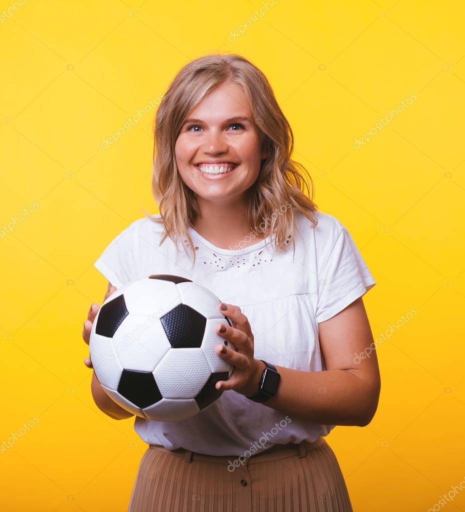 Portrait Of Cheerful Woman Holding Soccer Ball While Standing Over Yellow Backgr Ad Woman Holding Portrait Cheerful Ad Soccer Ball Soccer Cheer