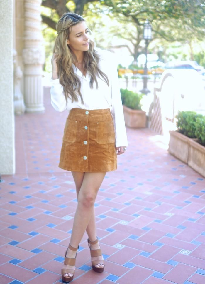 eb27f6e0ff Ways to Wear Spring s Biggest Trend  The Brown Suede Skirt - classic white  blouse tucked into a 70s inspired tan suede mini skirt + worn with chunky  ...