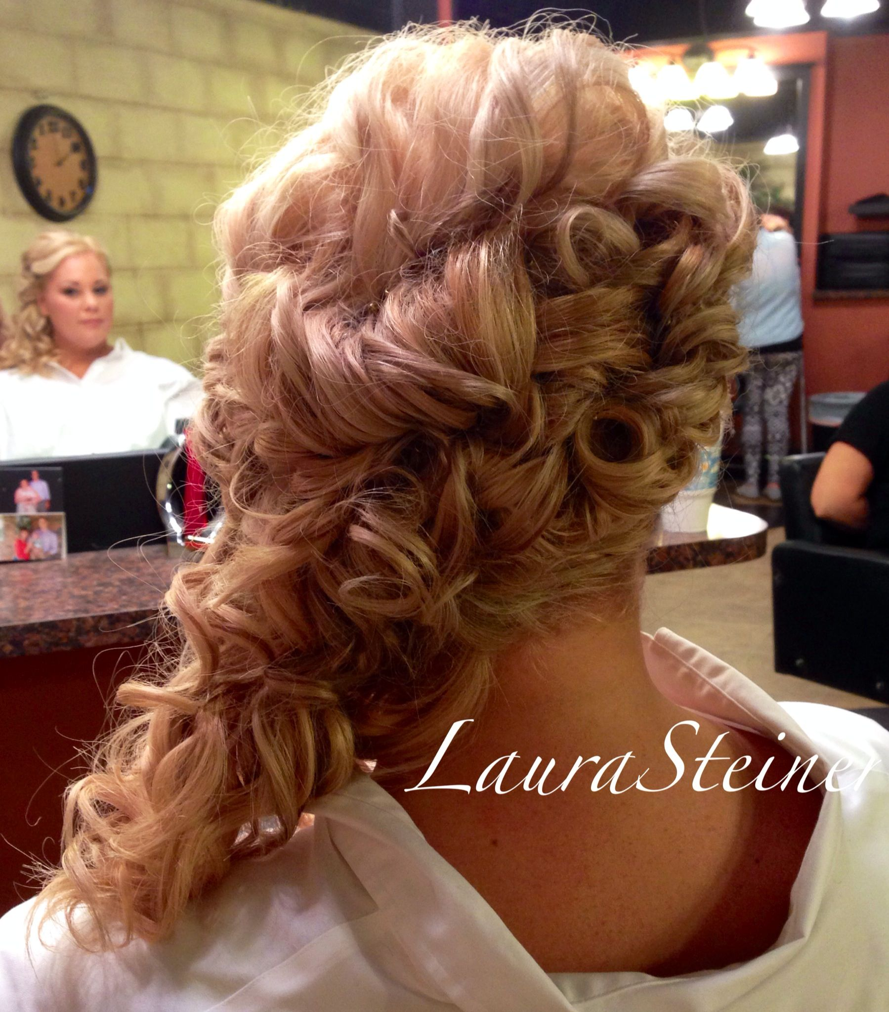 Bridal updo with cascading curls off one shoulder Lots of detail