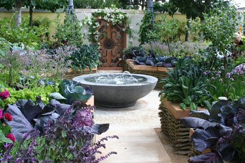The M&G Garden by Bunny Guiness. Chelsea Flower Show 2011. Love that wattle & lacinato kale!