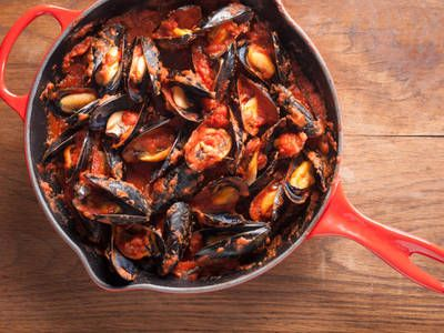 The homemade marinara sauce adds an exquisite flavor to the mussels. Enjoy alone or over pasta.