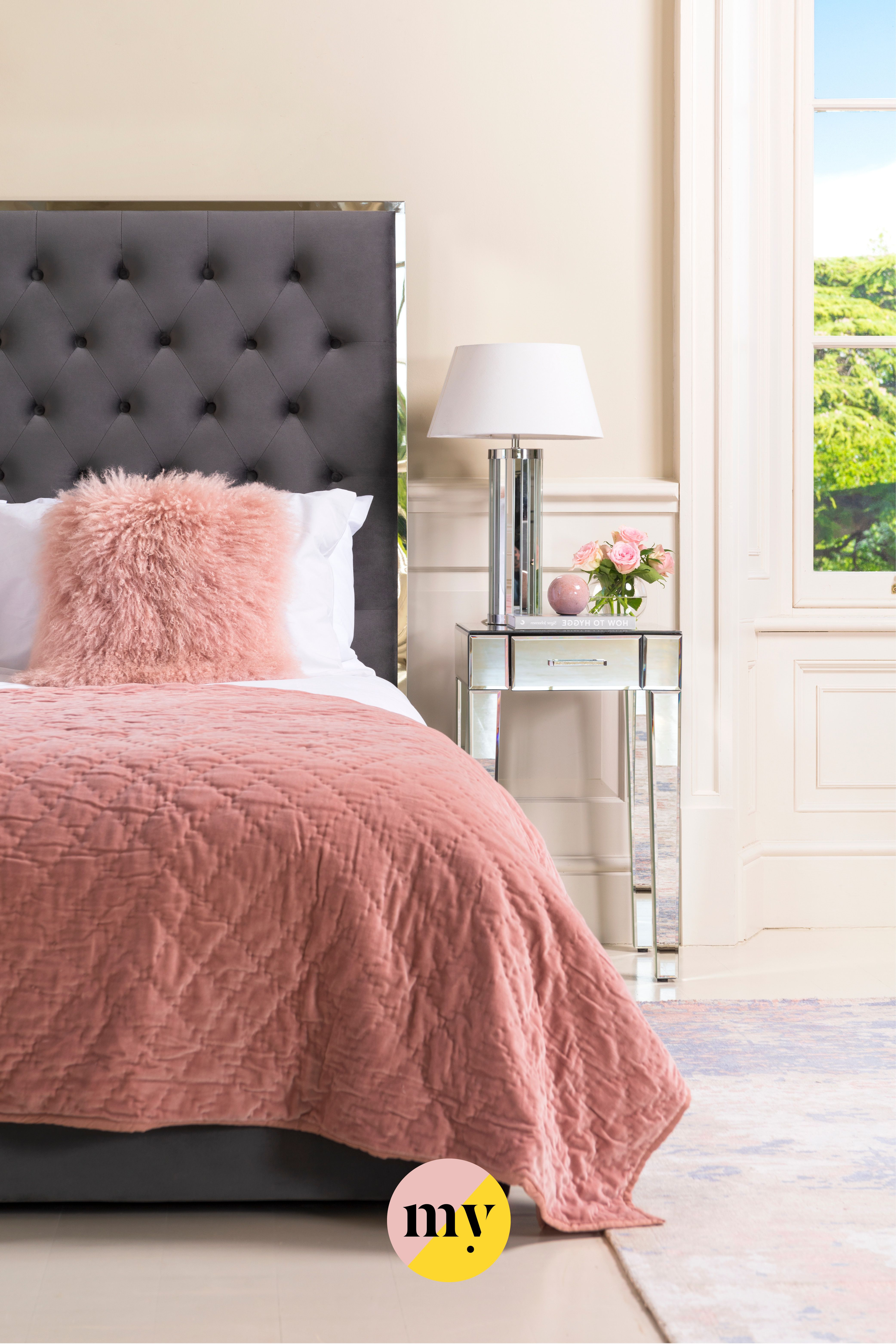 This bed has an impressive tall headboard with deep