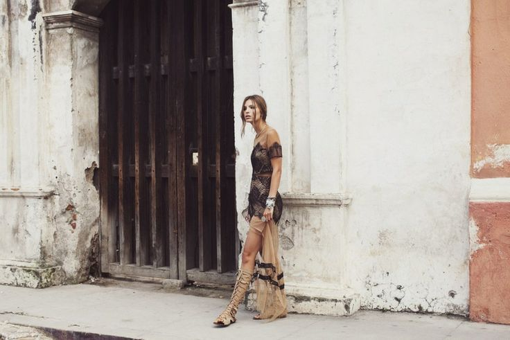 South American style. Embroidery and black lace dress.