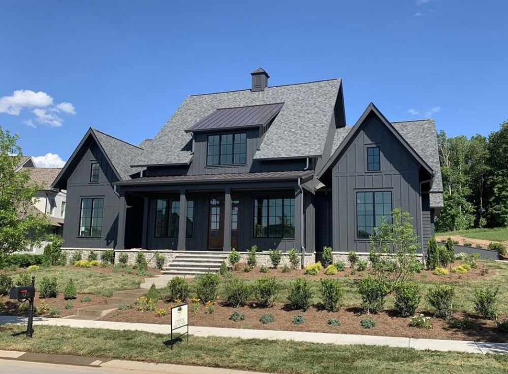 Tired Of White Farmhouses Legendhomestn Made This Black Exterior Steal The Show Black House Exterior White Farmhouse Exterior Modern Farmhouse Exterior