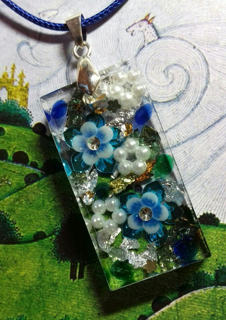 resin floral pendant made with sequins gold and silver foil small