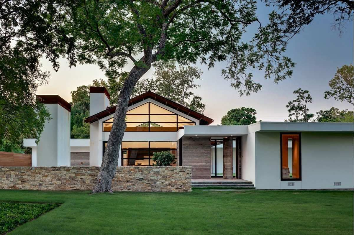 white tpo roofing membrane on a modern ranch style home | roof