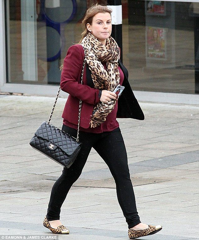 74fbd6ff7c2c Animal magic: Coleen Rooney jazzed up her simple berry and black outfit  with the addition of a leopard print scarf and matching flat pumps