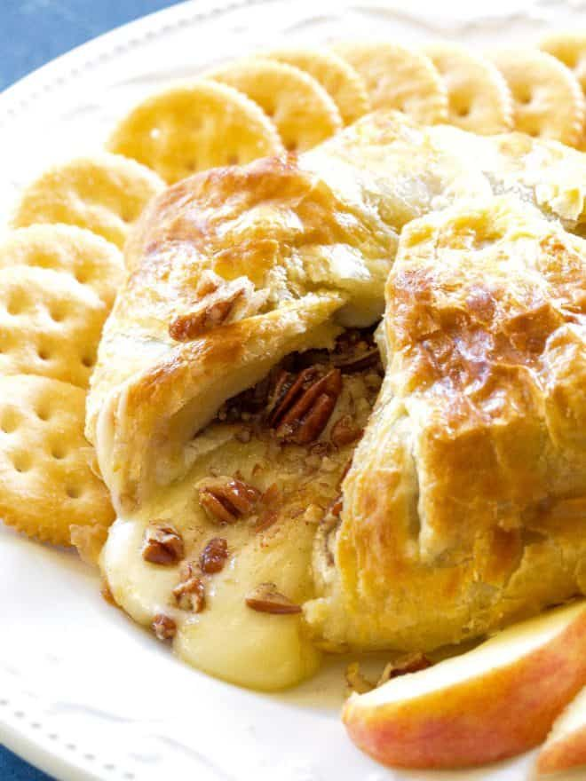 Baked Brie This Baked Brierecipe might be one of my all time favorite appetizers. There are layers of flaky pastry dough, brie cheese, brown sugar, and cinnamon pecans in this Baked Brie. the-girl-who-ate-