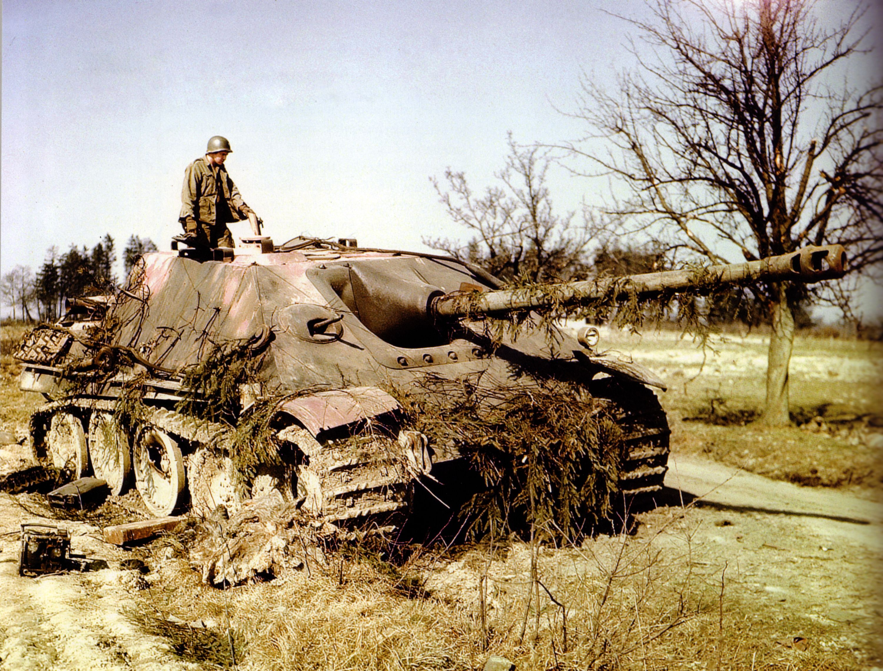 American GI examines knocked out German Panther tank, 1944.