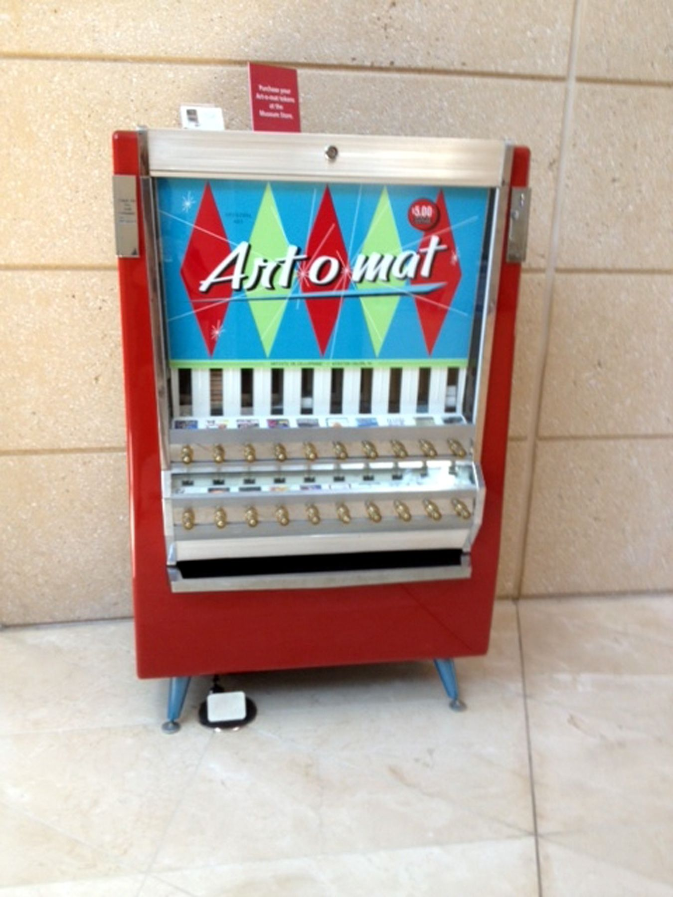 The Art-o-mat at the Museum of Fine Arts in St. Petersburg. For five dollars you get a small piece of hand crafted art dispensed from this converted cigarette machine. A cool reinvention!