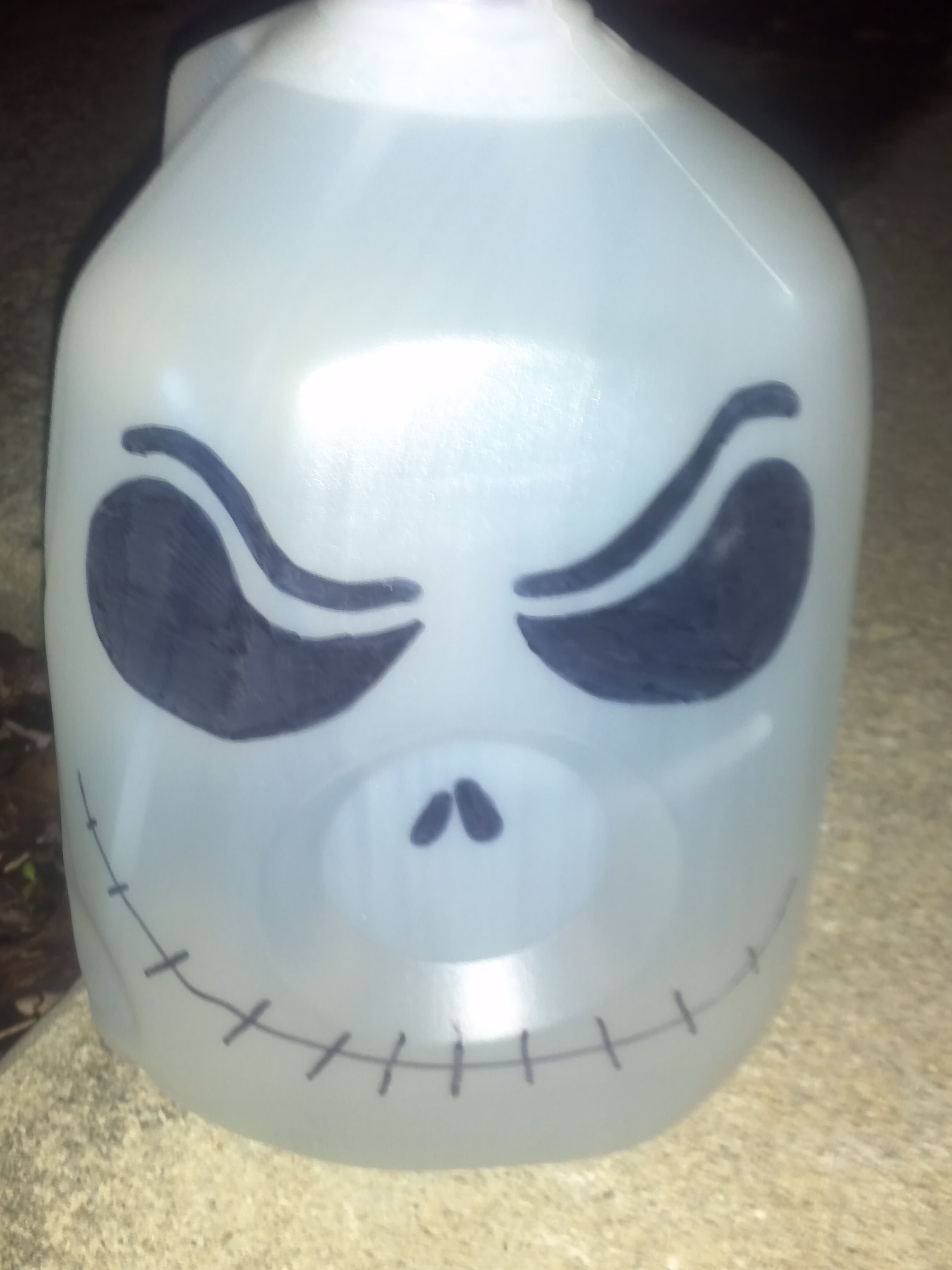 made ghost jack o lanterns from old milk jugs using a