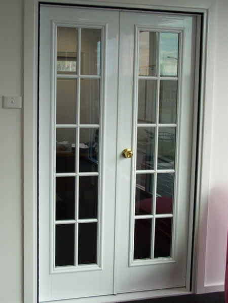 Two single swing doors used in tandem will make a french for Used french doors