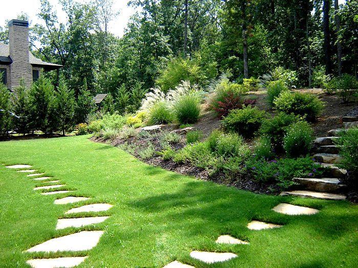A Backyard Landscape In Marietta Georgia With Irregular Flagstone Steppers,  A Bermuda Lawn, And