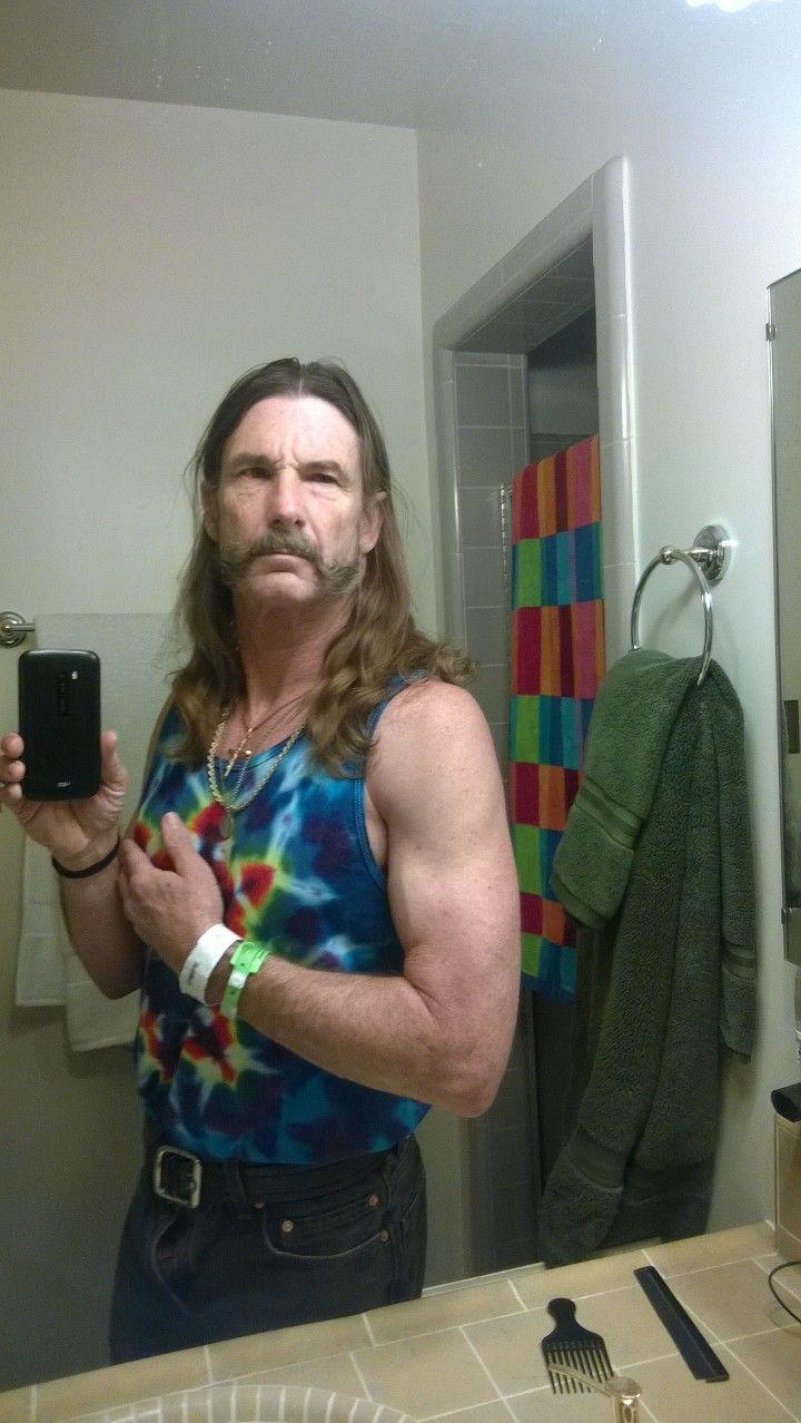 60 year old clothing model.   men long hair   long hair
