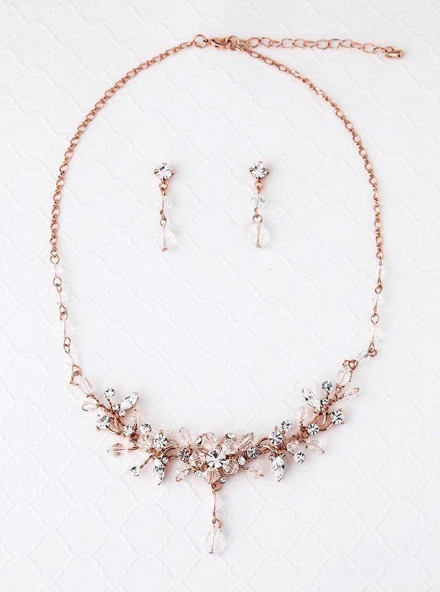 2a25a183ed Elegant and sophisticated, this rose gold or silver plated necklace and earring  set features an assortment of clear Swarovski crystal beads and  rhinestones, ...