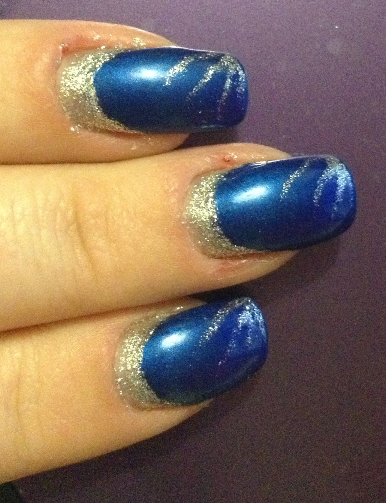 Dark blue nails with silver crescent and silver fanning? Not sure ...