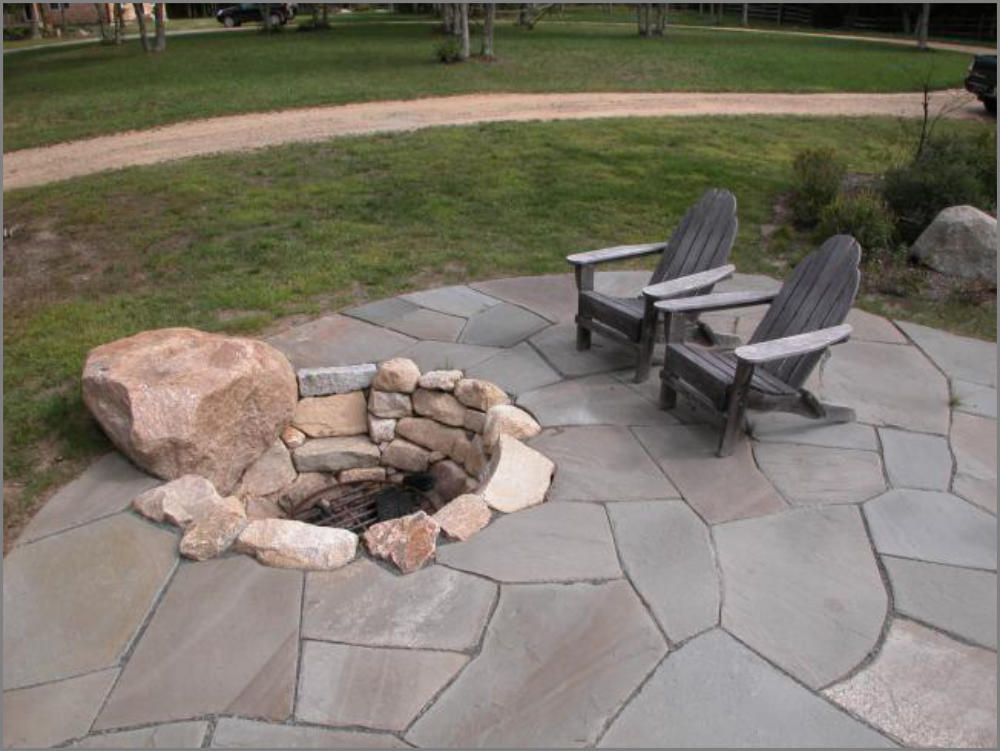 Sunken natural stone fire pit natural stone fire pits for Backyard rock fire pit ideas