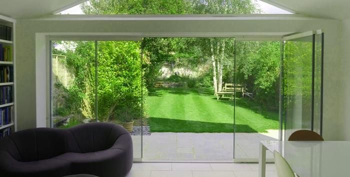 Frameless Glass Sliding Doors Bringing The Garden Inside Porches