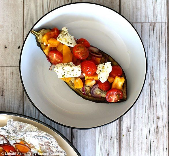 Mediterranean Stuffed Aubergine with Baked Feta - get recipe here: http://www.dailymail.co.uk/femail/food/article-4537722/How-feed-two-people-just-27-ban-holiday.html