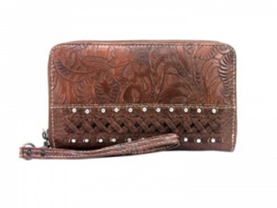 Genuine leather wristlet wallet by Trinity Ranch. High quality light brown leather with tooling, leather braiding, and a few metal accents. Zippers closed. Wrist strap included.
