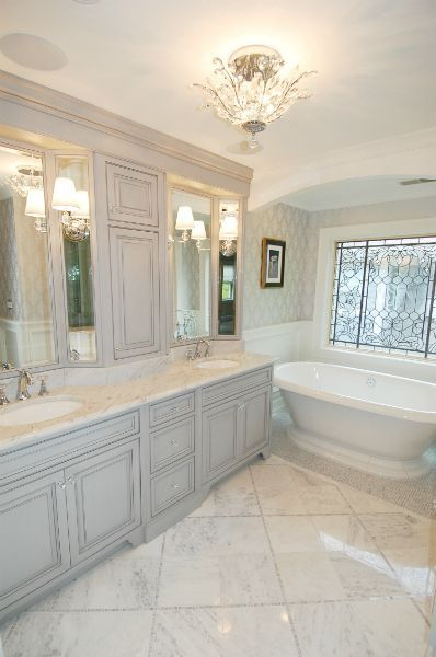 Arch over free standing tub. Tile detail. Light grey ...