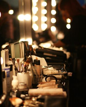 Bright lights, mirror displays resembling backstage of a fashion show.  door ...
