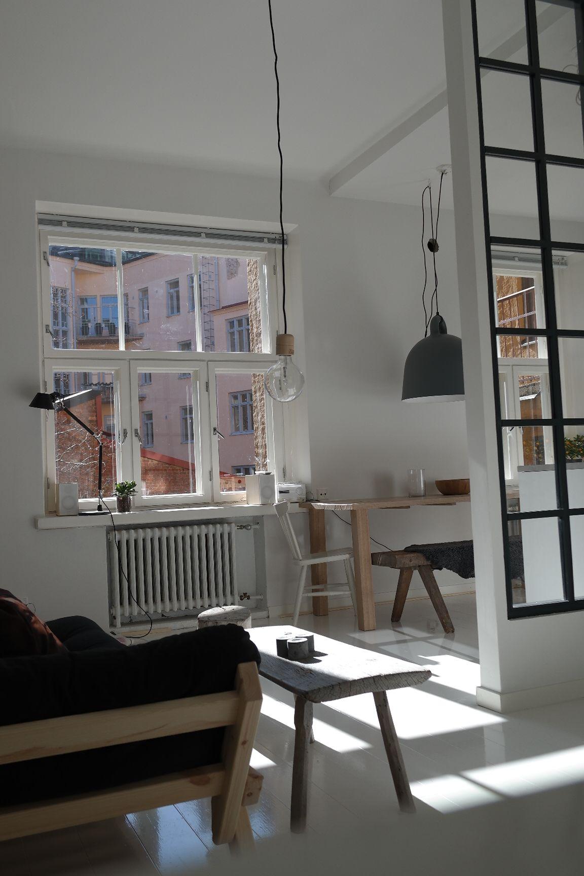 Luminous loft apartment with window wall element