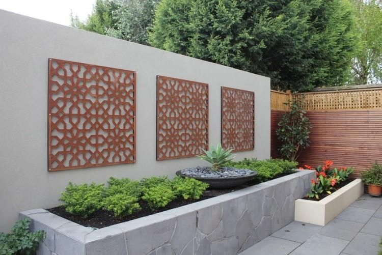 Creative idea modern outdoor home design with high grey for Small fenced in patio ideas