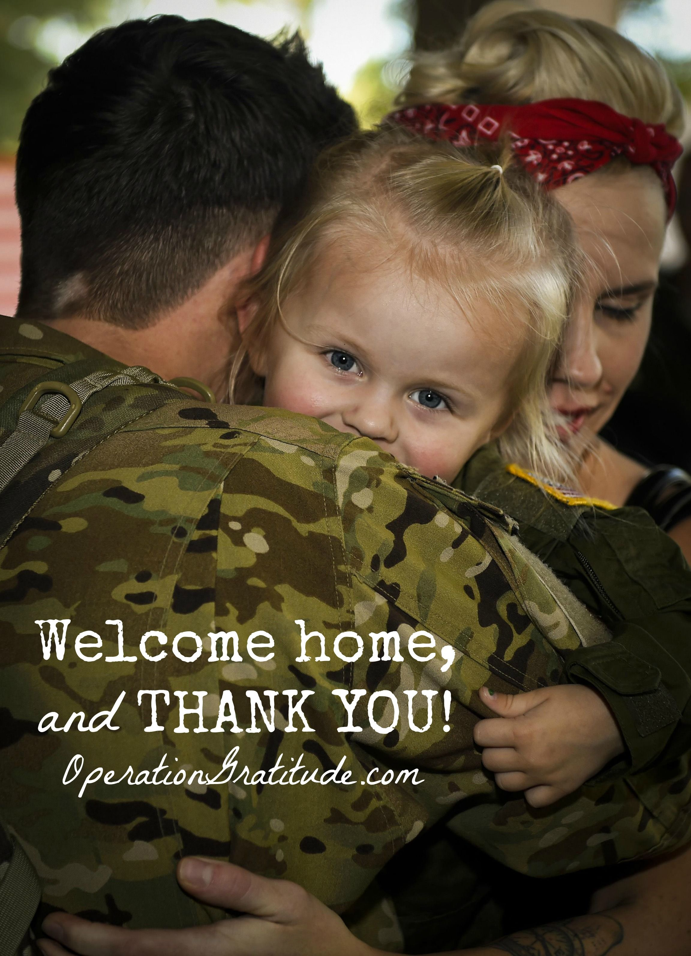 Tech Sgt. Andrew Melton embraces his loved ones after