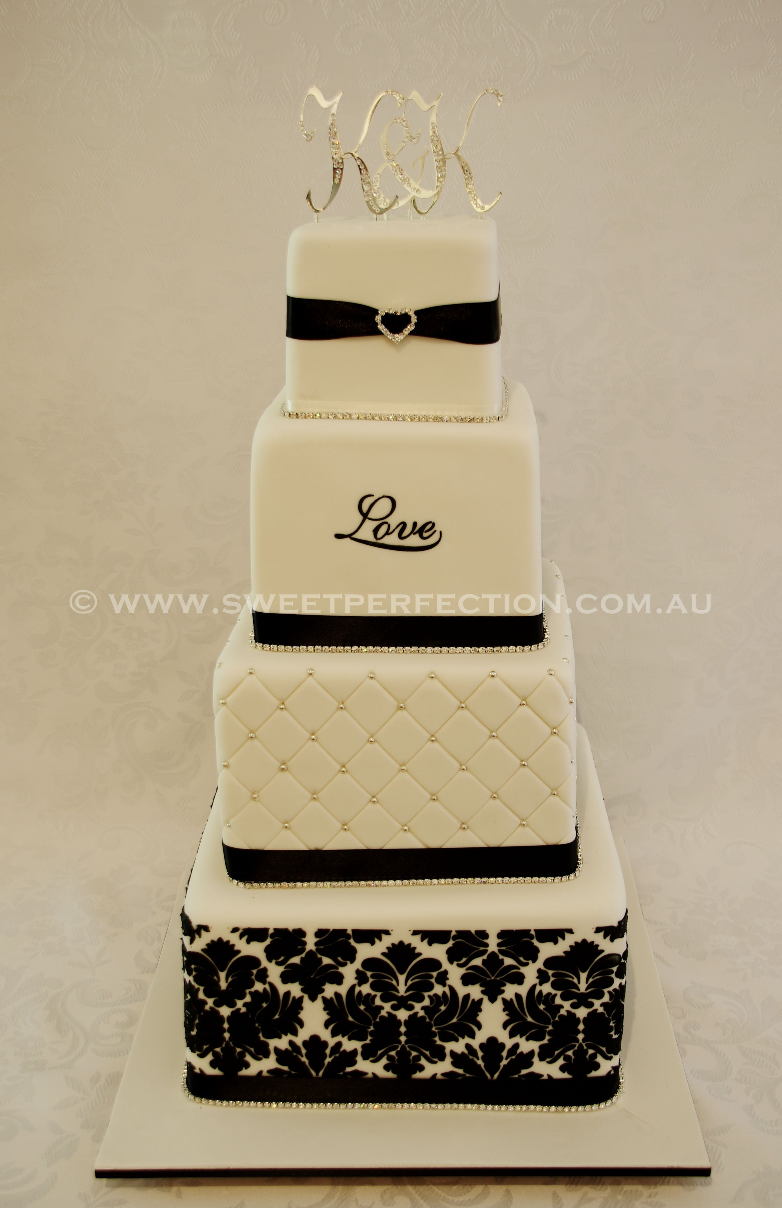 Wedding decorations styles october 2018 Black and white with bling in four square tiers Seriously elegant