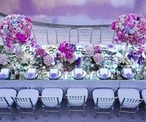 Nothing like an antiqued mirror to reflect roses, hydrangeas and fuschia phalaenopsis orchids.