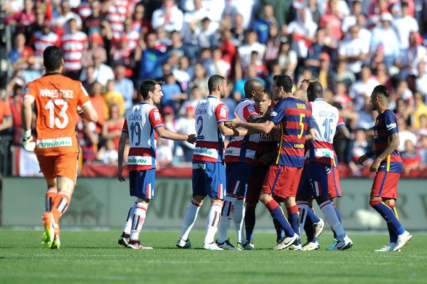 Players argue during the La Liga match between Granada and Barcelona at Estadio Nuevo Los Carmenes on May 14, 2016 in Granada, Spain.