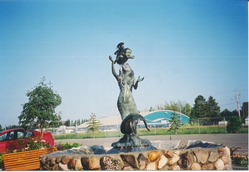 Mermaid and Child Statue at the 50th Ave Information ...