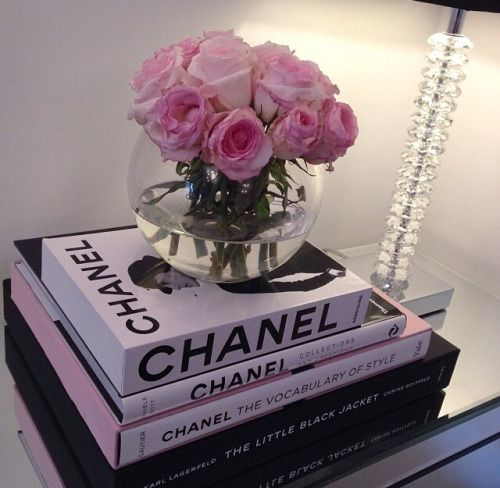 Chanel. Pink Flowers. Stacked Books.