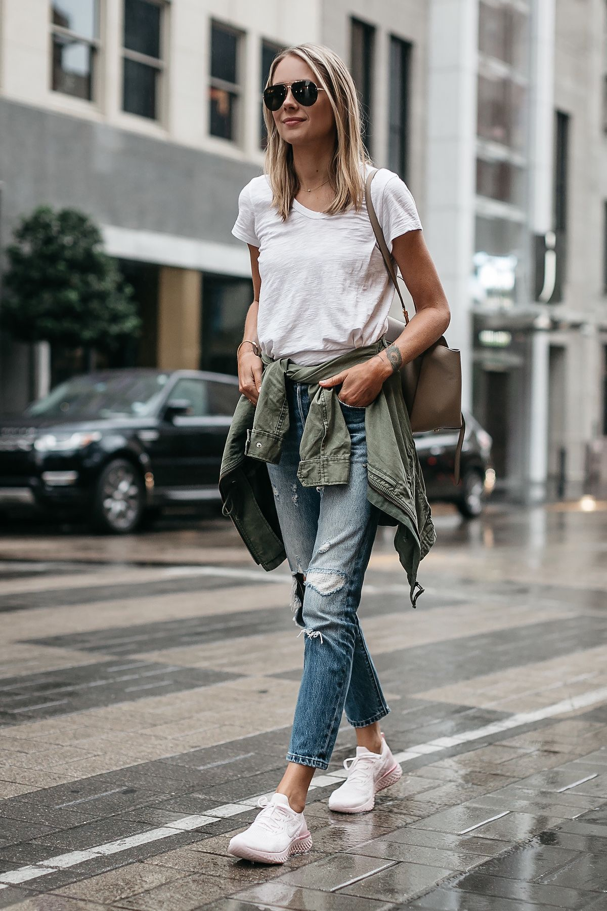 20ebe83b22a ... Woman Wearing Nike React Running Shoe White Tshirt Ripped Denim Jeans  Green Utility Jacket Fashion Jackson Dallas Blogger Fashion Blogger Street  Style