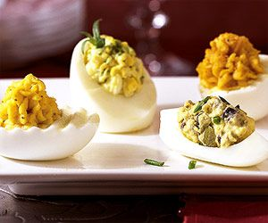Smoked Oyster Deviled Eggs (simple version)..... with 1 can smoked oysters, chives, dijon, mayo... garnished with chives